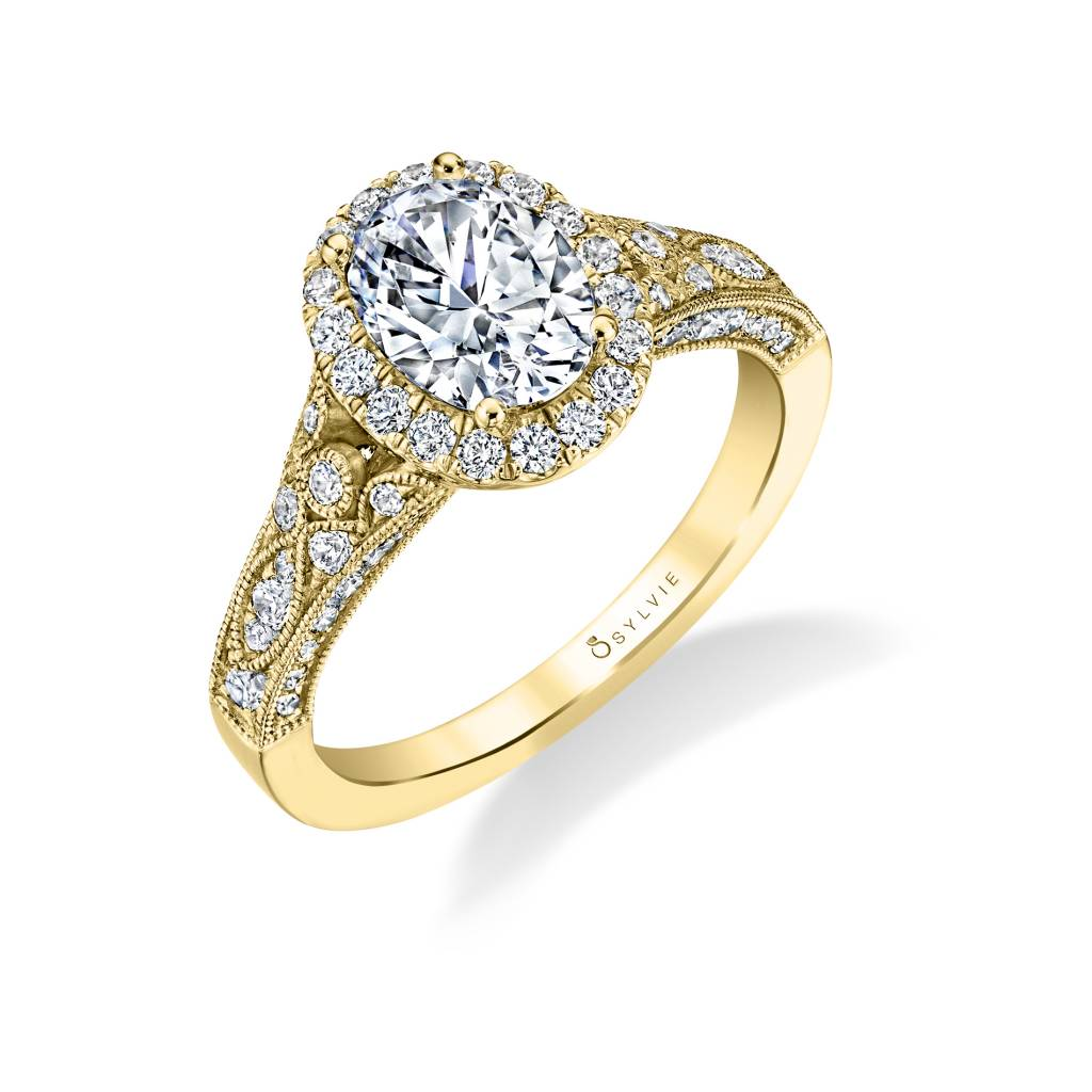 vintage inspired yellow gold oval halo engagement ring